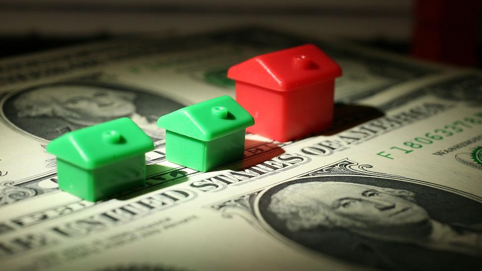 Monopoly houses on dollar bills