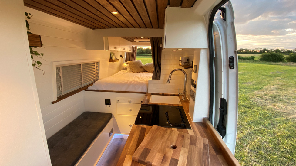 A picture of an interior of a van conversion