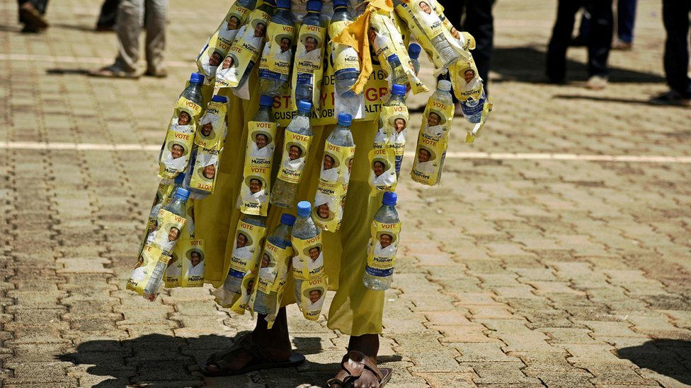 A pro-Museveni water bottle skirt at a campaign rally, Uganda -