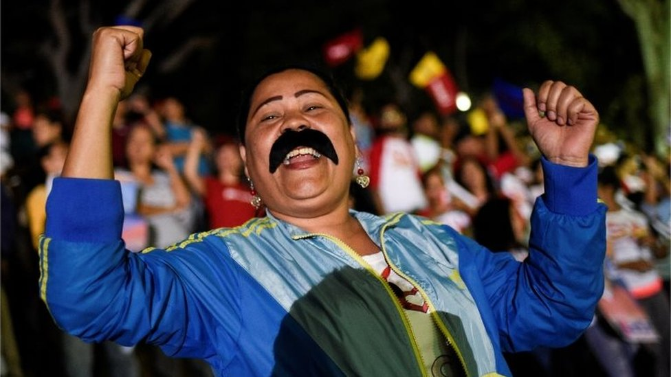 Supporters of the Venezuelan President Nicolas Maduro celebrate after the National Electoral Council (CNE) announced the results of the voting on election day in Venezuela, on May 20, 2018 in Caracas.