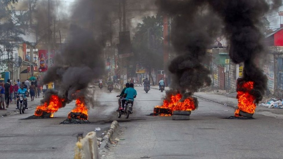 Protesters block the streets leading to the house of the President of Haiti, Jovenel Moise, during a new day of protests in Port-au-Prince, Haiti, 24 February 2020.