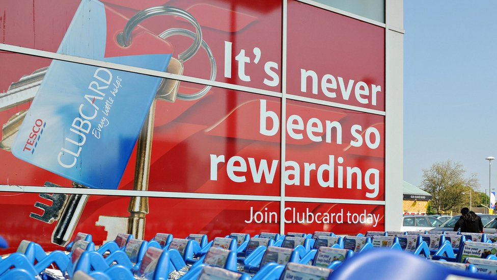 Tesco clubcard sign with trolleys