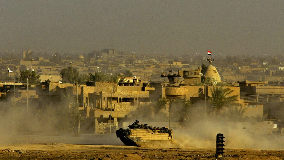 US marine vehicle patrols the Jolan neighborhood of the restive Sunni Muslim city of Falluja on 11 November 2004