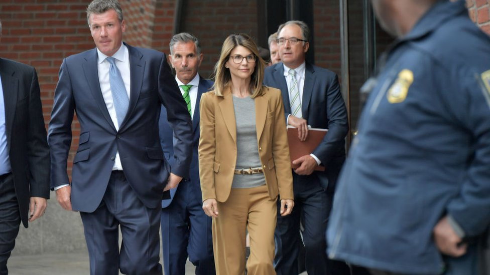 Lori Loughlin exits the John Joseph Moakley U.S. Courthouse after appearing in Federal Court to answer charges stemming from college admissions scandal on April 3, 2019 in Boston, Massachusetts.