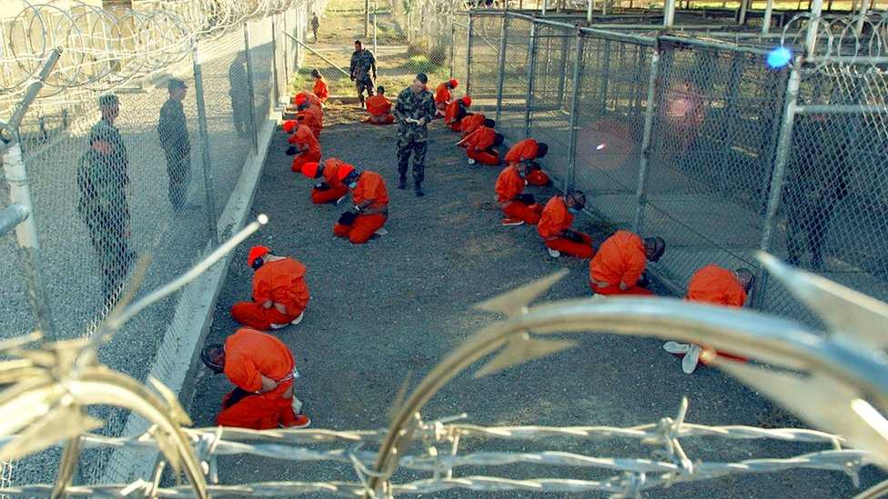 Taliban and al Qaeda detainees in a holding area at Camp X-Ray at Guantanamo Bay in January 2002