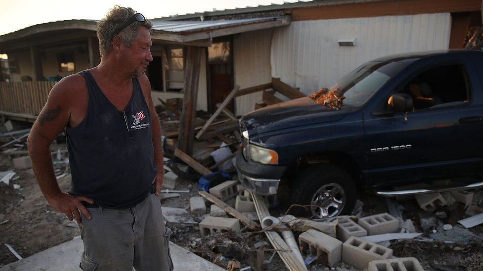 A man checks the damage to his home in Florida after Hurricane Irma last year