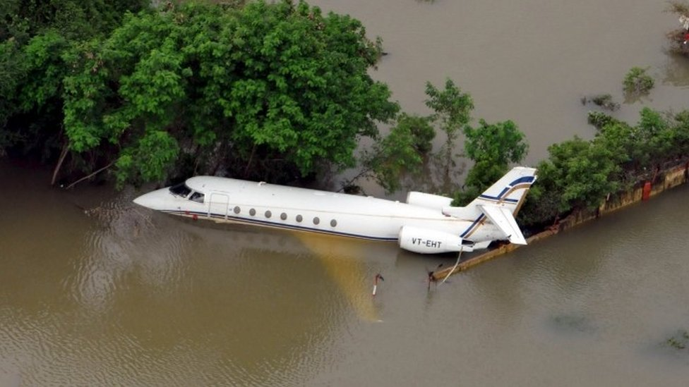 An aerial view of a partially submerged airplane is pictured in a flood affected area in Chennai, India, December 3, 2015