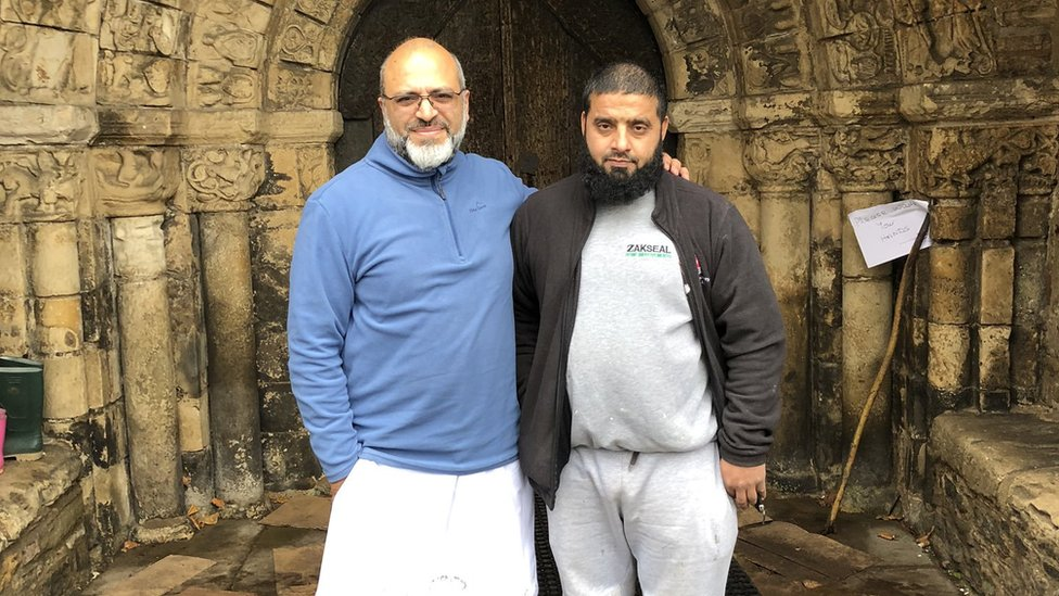 Two members of the Bradford Muslim community deliver supplies