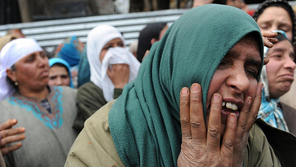 Kashmiri women mourn during the funeral of slain Indian army soldier Shabir Ahmed Malik at Dab Wakoora, northeast of Srinagar, in Indian-administered Kashmir on March 24, 2009.