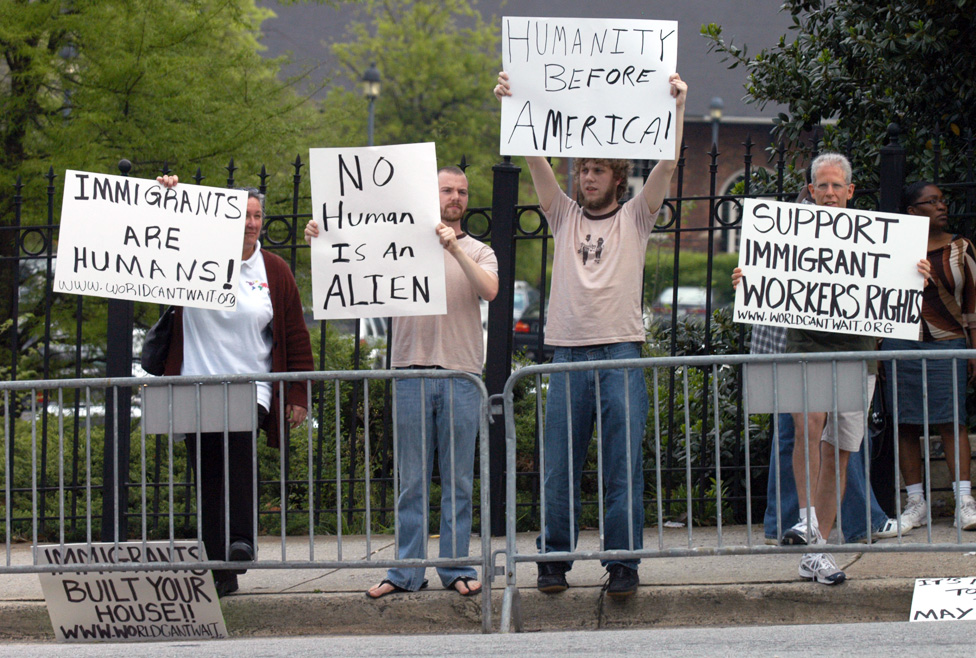 Counter-demonstrators display signs during an immigration rally on the steps of the state Capitol April 17, 2006 in Atlanta, Georgia.