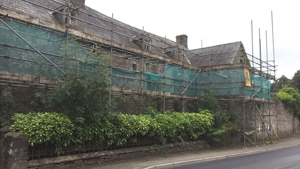 Scaffolding surrounds the frontage of the building