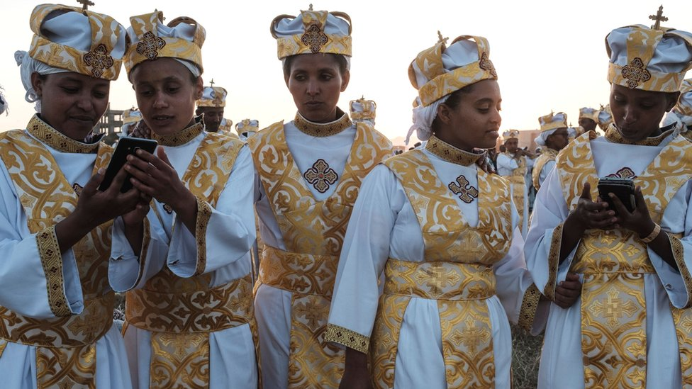 Orthodox Ethiopians using smart phones in Addis Ababa - January 2019