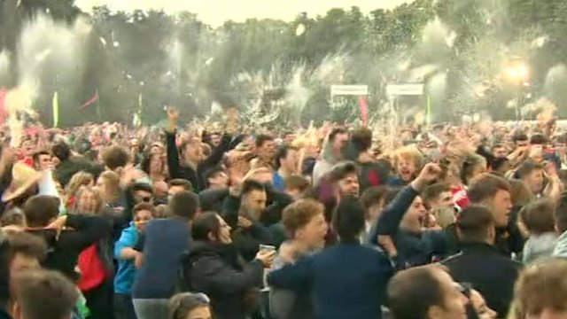 Wales fans in Cardiff's fanzone celebrate Wales' third goal against Belgium in the Euro 2016 semi-final