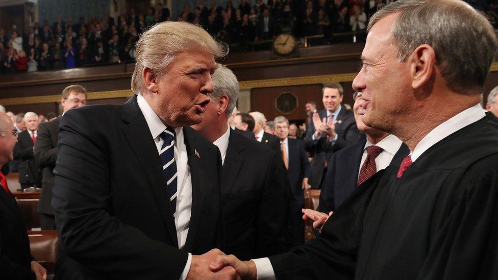 Trump shakes Justice Roberts' hand