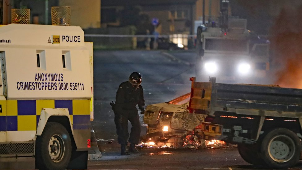 A police officer in riot gear at the scene of the violence in Londonderry
