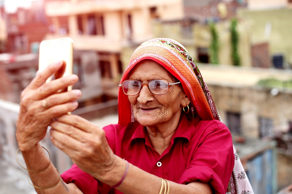Old woman using a smartphone.