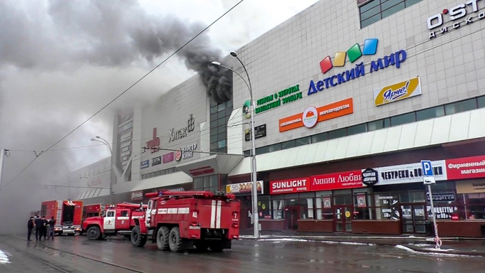 Emergency vehicles outside a burning shopping centre in Kemerovo, Russia. 25 March 2018