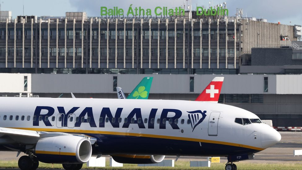 Ryanair profits hit by higher wage costs