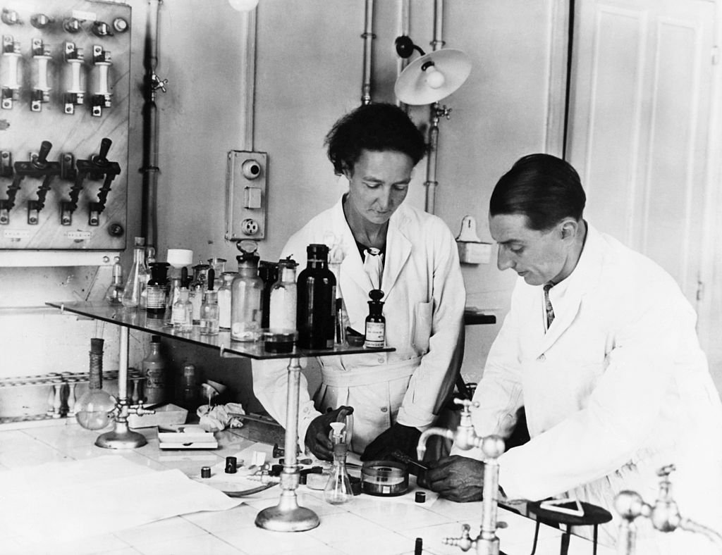 Paris, France: Frederick Joliot and his wife, Irene Curie, Physicists, who shared the Nobel Prize in 1935. Photograph in their laboratory.