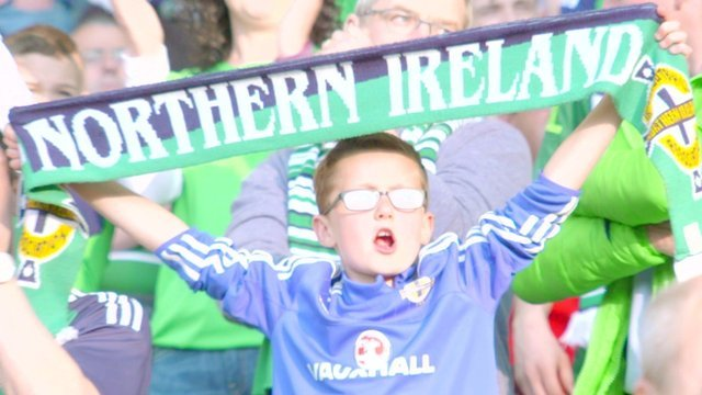 A young fan shows his support for Northern Ireland