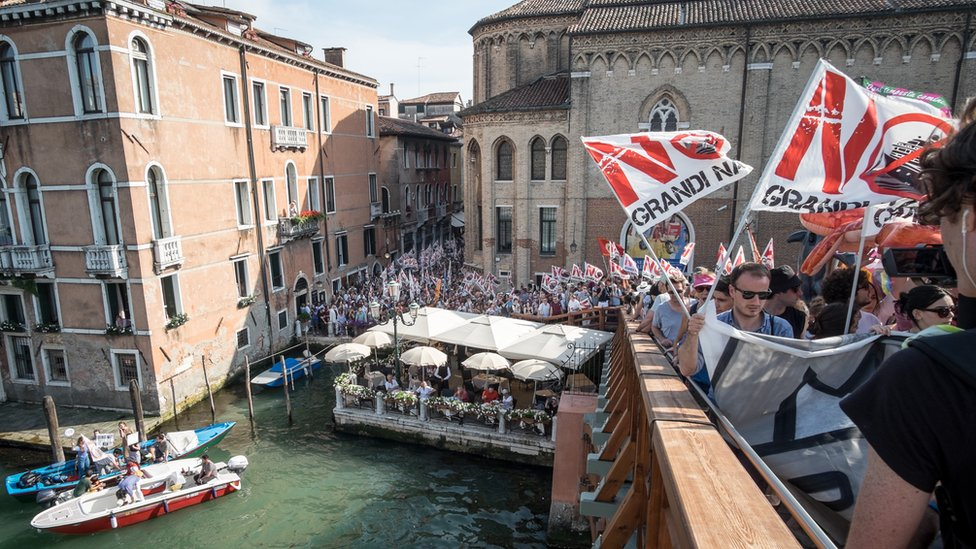 People take part in a demonstration against the passage of cruise ships in Venice Lagoon, on June 8, 2019