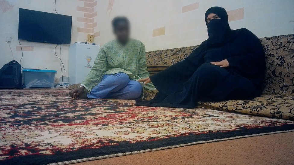 16-year-old Fatou (not her real name) from Guinea is filmed with her seller in Kuwait City