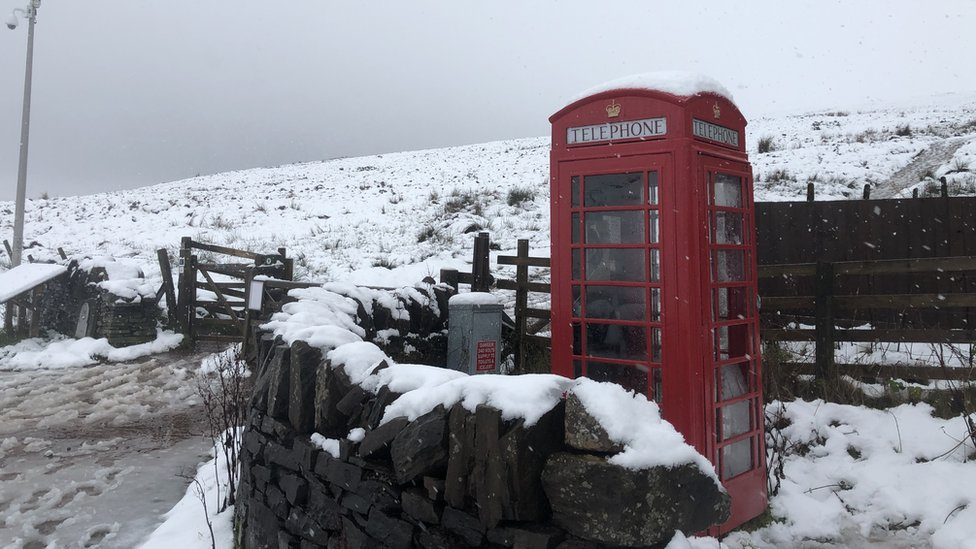 A phone box surrounded by snow in Libanus, Powys