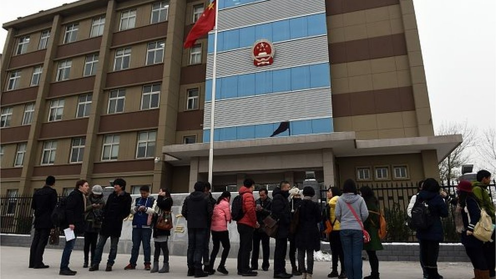Journalists and gay rights activists stand outside the Beijing No.1 Intermediate People's Court in Beijing before lesbian activist Qiu Bai enters on November 24, 2015.