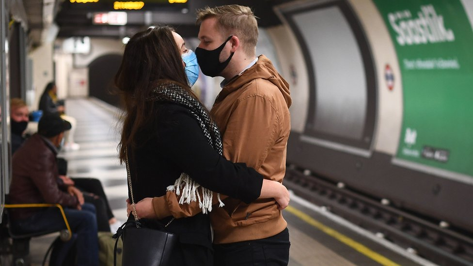 People on the Northern Line in central London after the 10pm curfew, which was put in place on Thursday with a range of new restrictions to combat the rise in coronavirus cases in England