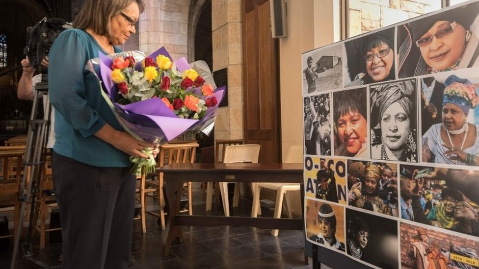 """Cape Town mayor Patricia de Lille brings flowers for a memorial at St George""""s Cathedral for the late South African anti-apartheid campaigner Winnie Madikizela-Mandela"""
