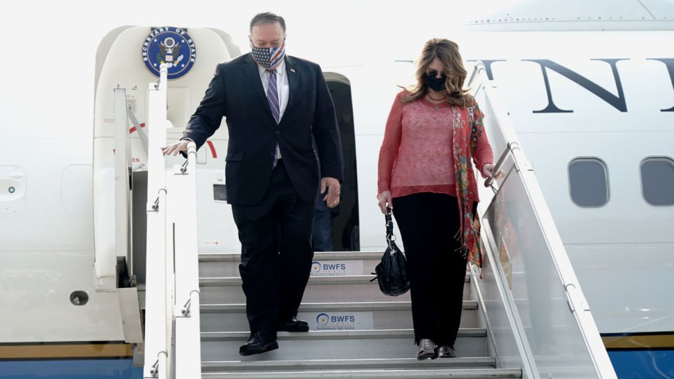 Secretary of State Mike Pompeo, and his wife Susan Pompeo disembark from an aircraft upon their arrival at the airport in New Delhi, India on October 26, 2020