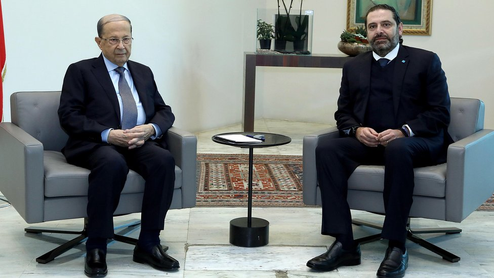 Lebanese President Michel Aoun and outgoing Prime Minister Saad Hariri at the Baabda presidential palace on 19 December 2019