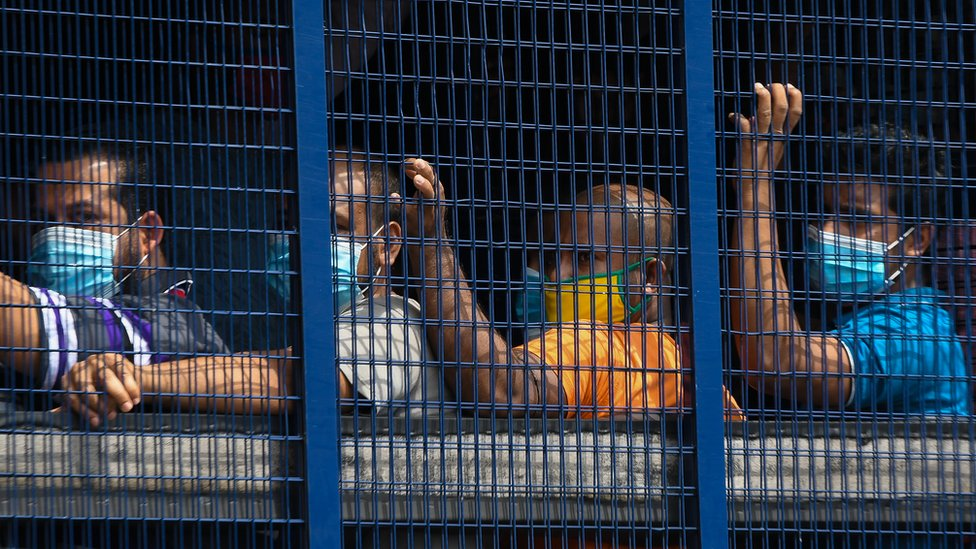 Migrants taken for detainees after immigration launched an operation to arrest undocumented migrants in Kuala Lumpur