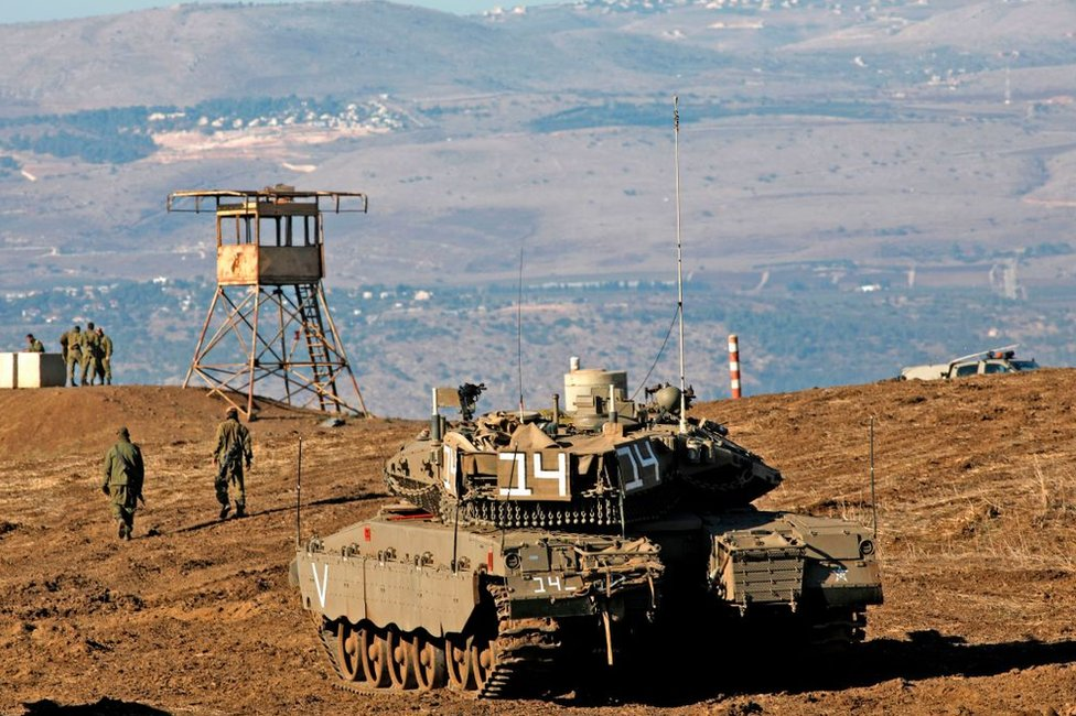 File photo showing Israeli soldiers and armoured vehicles pictured near the frontier with Syria in the occupied Golan Heights (19 November 2019)