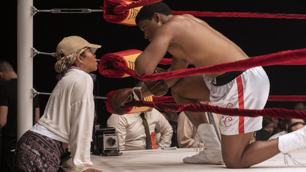 Regina King directing Eli Goree as Cassius Clay/Muhammad Ali in One Night In Miami