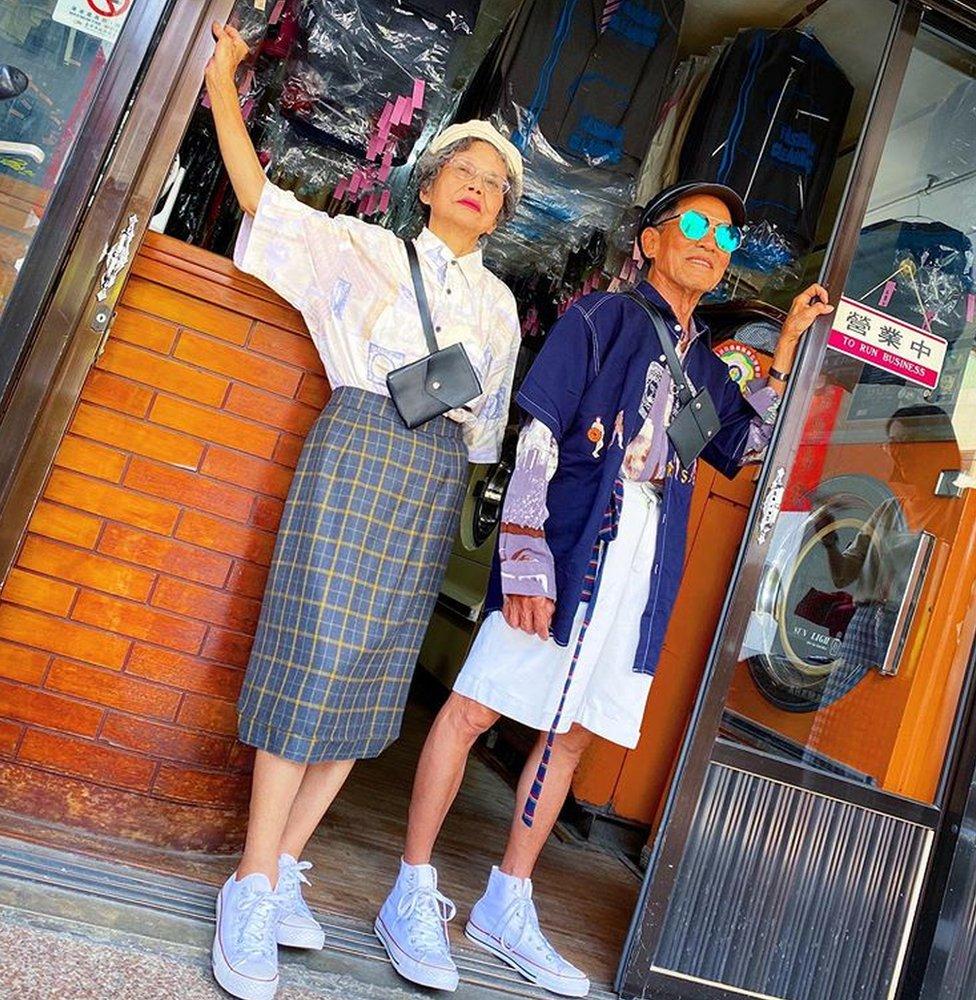Chang Wan-ji and Hsu Hsiu-e pose outside their shop