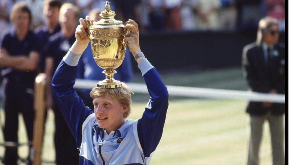 Boris Becker, at seventeen (the youngest ever mens winner), holds aloft the Mens Singles trophy at Wimbledon.