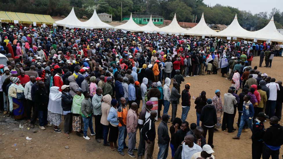 Voters queue as they wait to cast their votes at a polling station in the Kibera slum, Nairobi, Kenya