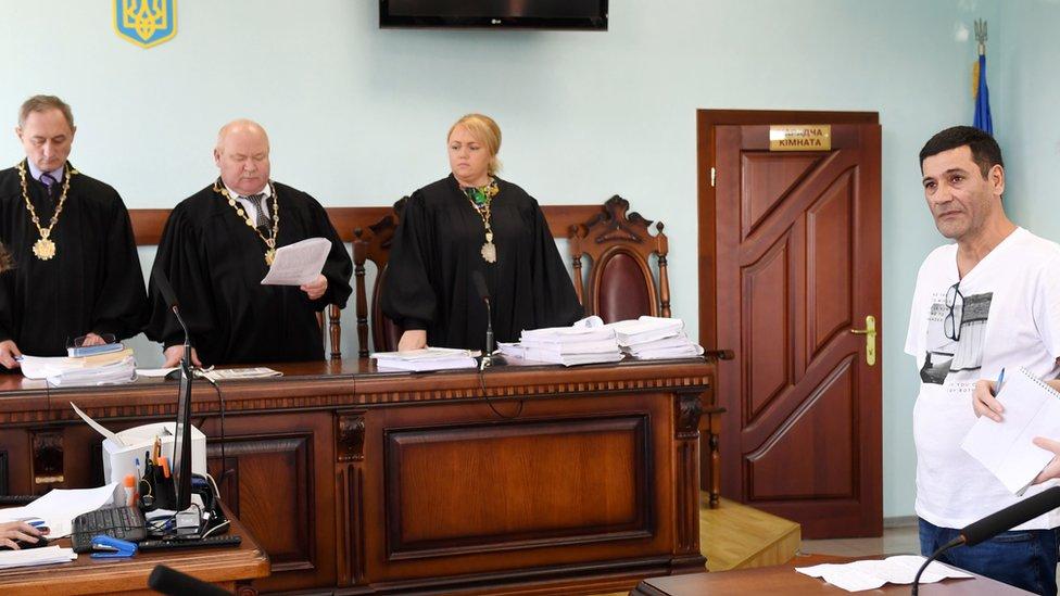 Gilbert Chikli listens to the verdict of the Court of Appeal, on September 26, 2017 in Kiev