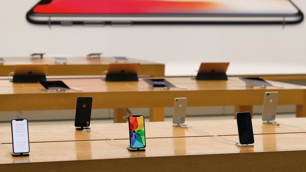 An Apple shop with phones on display
