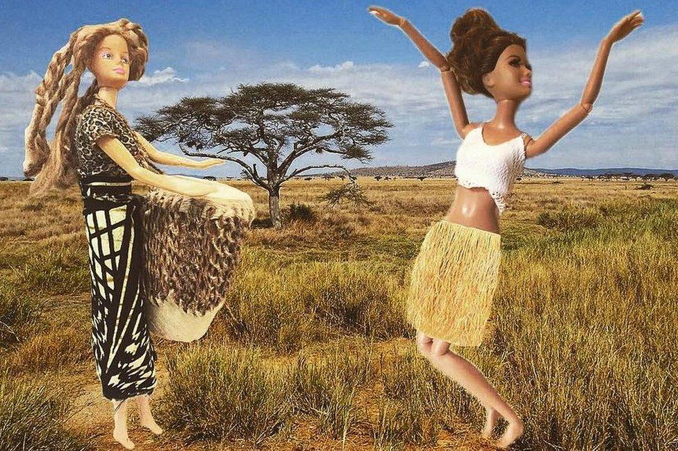 Two Barbie dolls dancing