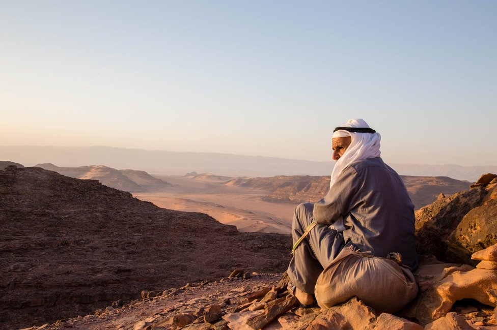 A tribesman of the Garasha looks over the rugged deserts of the Alegat