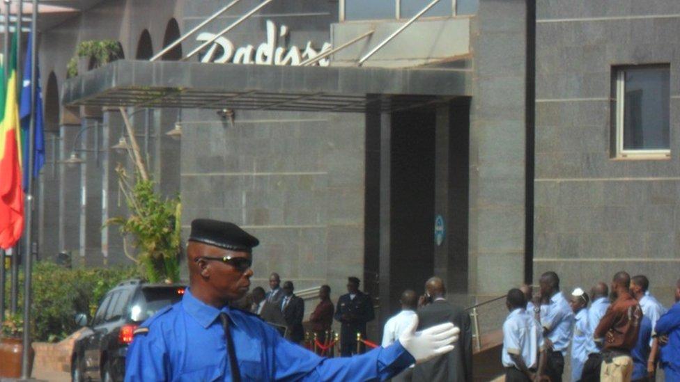 Someone directing traffic at the Radisson hotel, Mali - Tuesday 15 December 2015