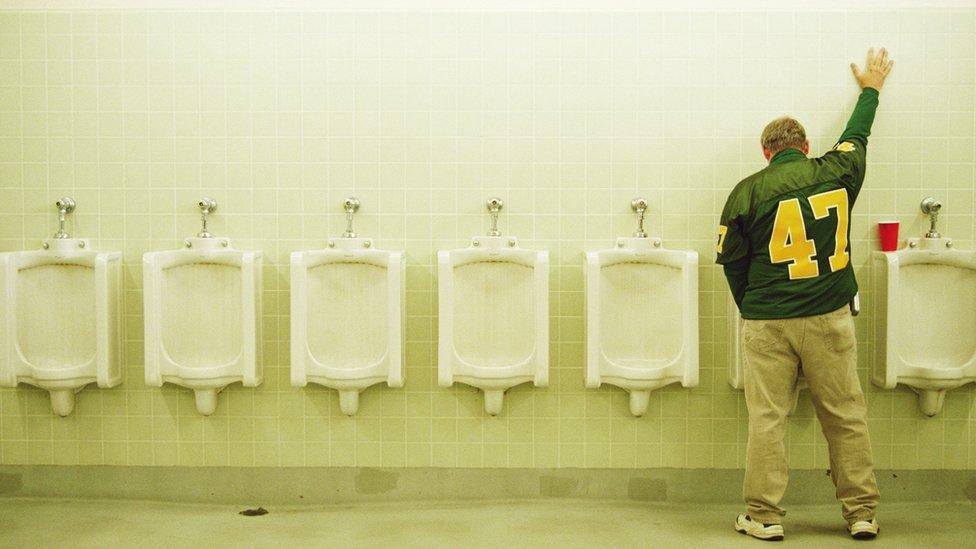 Man urinating.