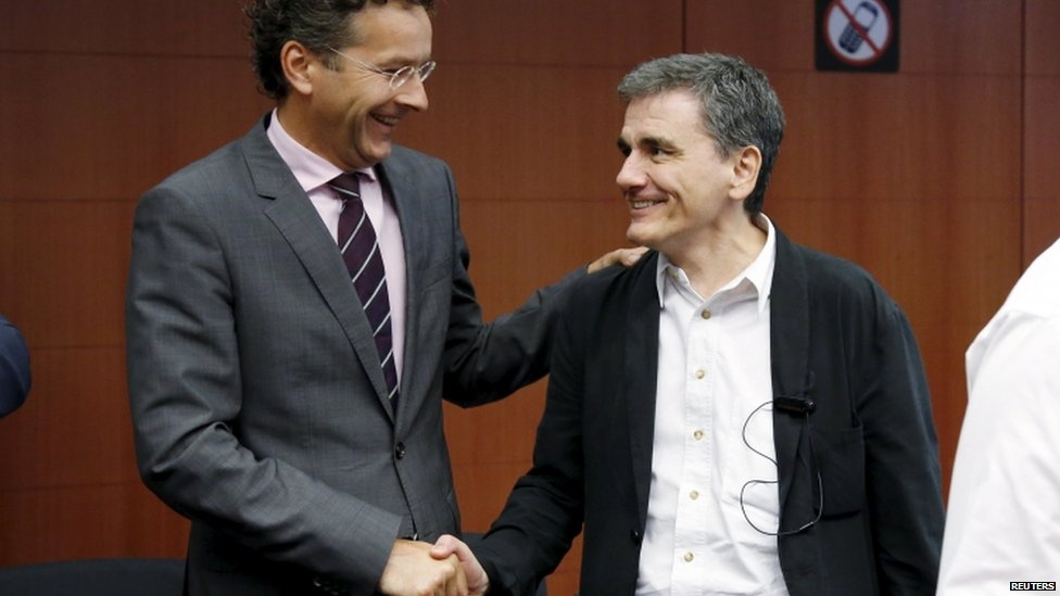 Eurogroup President Jeroen Dijsselbloem shakes hands with Greek Finance Minister Euclid Tsakalotos, 14 Aug