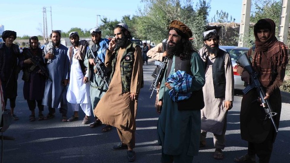 Taliban stand guard at a checkpoint as they took control of Herat, Afghanistan, 15 August 2021