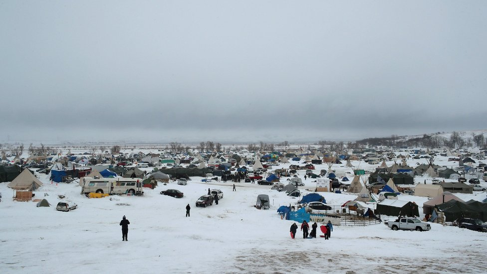 Snow covers the ground at Oceti Sakowin Camp on the edge of the Standing Rock Sioux Reservation on December 1, 2016