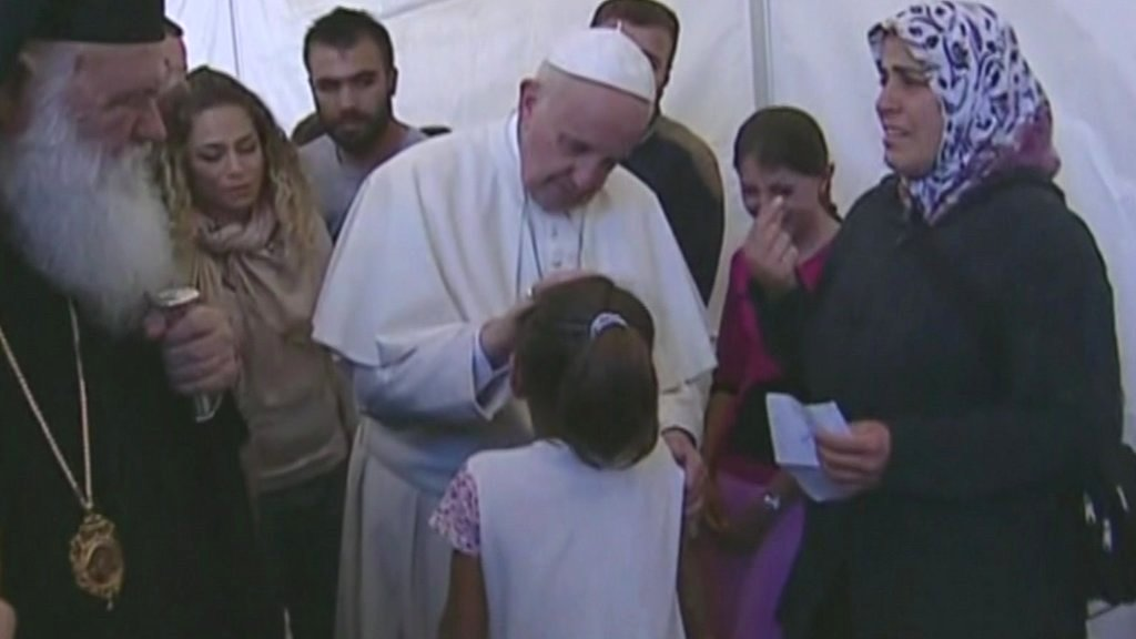 Pope Francis blesses a girl in the Lesbos migrant camp