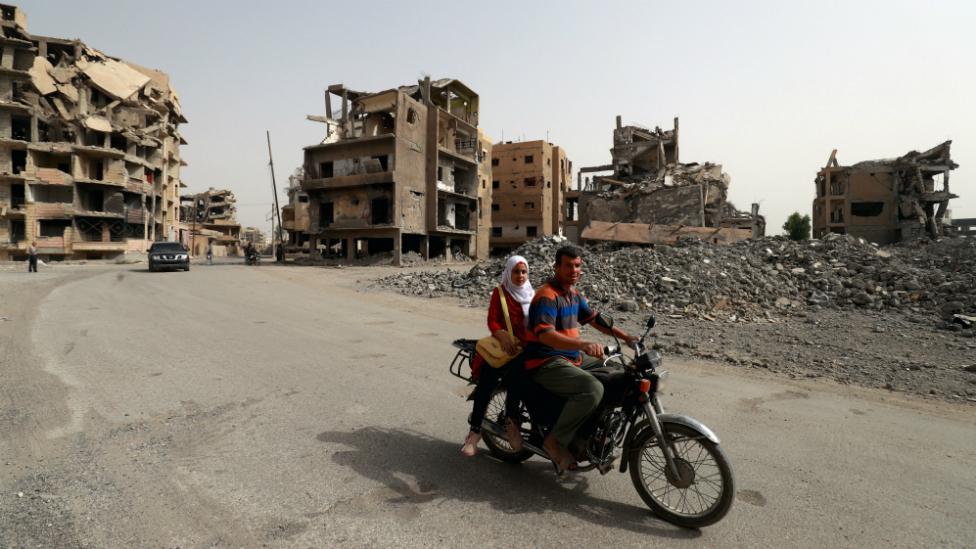 Who will help rebuild the city of Raqqa?