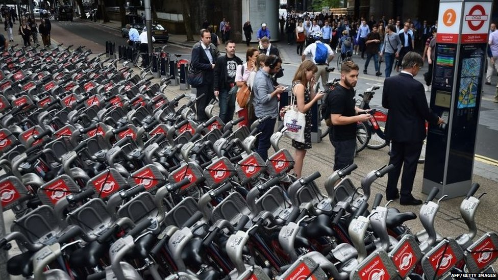Commuters queue to hire London rental bicycles as a tube strike hits the morning rush hour in the city of London